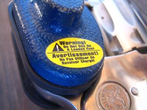 Trigger_lock_on_a_revolver_-_close_up_of_warning