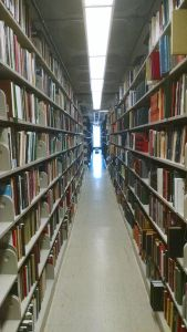 Library stacks. Photo by ndshankar, CC 4.0.